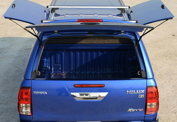 Alpha CMX gullwing truck top canopy with open side doors and tailgate on a Toyota Hilux