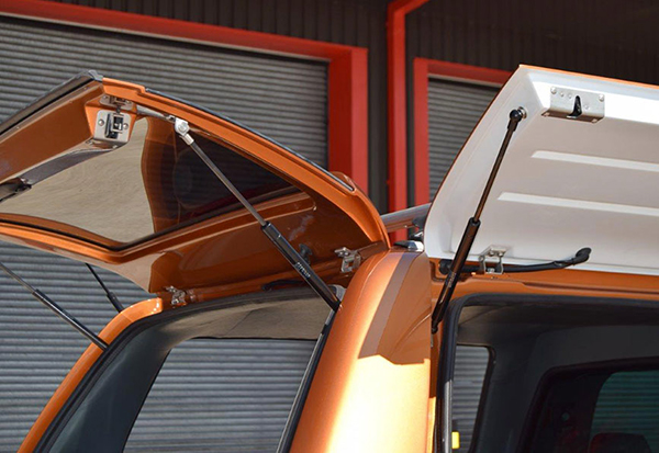 Ford Ranger fitted with an Alpha gullwing truck top canopy in pride orange