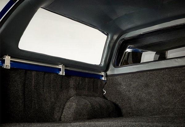 The interior of an Alpha CMX truck top canopy