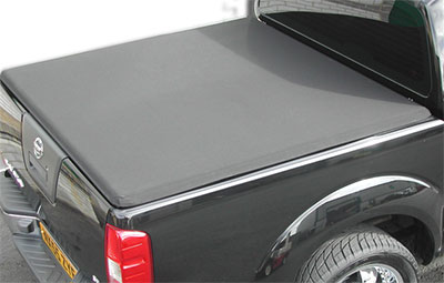 Top view of the hard tri folding load bed cover on a Nissan Navara