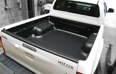 Toyota Hilux with an under rail bed liner