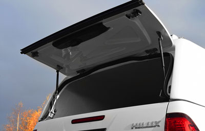 Close up of the open rear door of a mid roof tradesman canopy