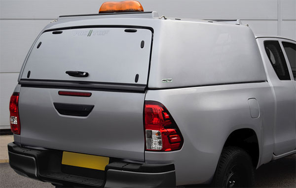 Rear view of the solid door on a Pro//Top mid roof tradesman canopy