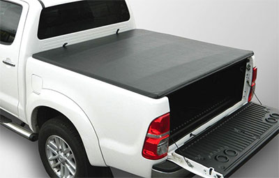 Taught soft hidden snap load bed cover on a pickup truck
