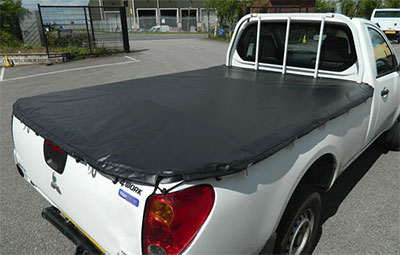 Mitsubishi single cab fitted with soft hooked load bed cover