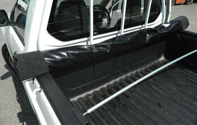 Rolled up soft tonneau cover showing support bars