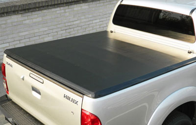 Soft tri folding load bed cover on a Toyota Hilux pickup